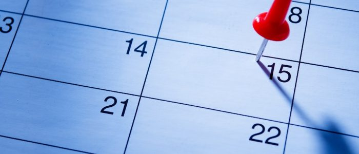 red-pin-marking-the-15th-on-a-calendar-FKYSCF3 (1)